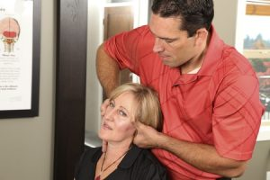 11154213 - chiropractor adjusting a female patient